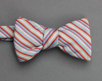 vintage carnival striped bow tie // self tie bow tie in red, plum, blue, and tan // striped bow tie for men