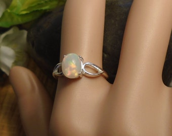 White Ethiopian Fire Opal Ring , Pink & Rainbow Play, Sterling Silver, 1.45 Cts Extreme Fire  8.20 x 6.50 mm Welo Ethiopian Fire Opal