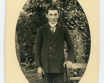 vintage photo 'Peculiar Guy/Photo' black and white portrait man guy gentleman in suit, odd awkard weird vibe