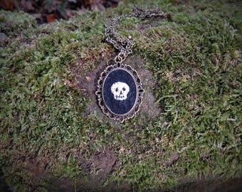 Hand embroidered skull cameo necklace