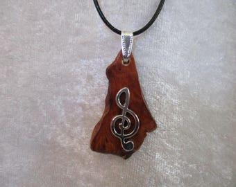 Treble clef silver metal pendant