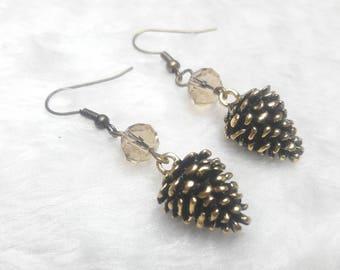 Handmade earrings with pine cones