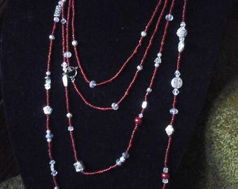 2 Strand Sparkly red glass seed beads embelleshed with Cystals and Tibetan Silver