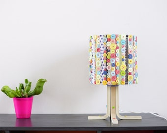 Seamed, table lamp customizable button