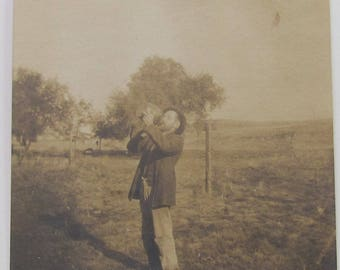 Victorian Man Drinks From Jug Antique Snapshot Funny Photo  Family Picture Paper Ephemera Photograph Is Faded From Age