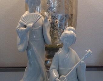 Two blanc de chine style geisha statues
