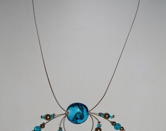 Brown and turquoise necklace on twisted wire