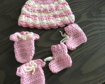 Pink and white hat, booties, and mittens set