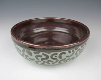 large porcelain bowl with iron-red and celadon glaze