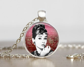 Audrey Hepburn pendant on burgundy backdrop, necklace is a soldered cable chain with a lobster clasp (151)