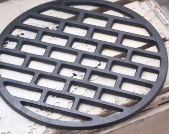 """11"""" grill or trivet manufactured in 1952, Cast Iron Grate"""