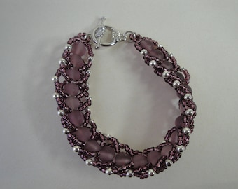Purple woven glass bead bracelet