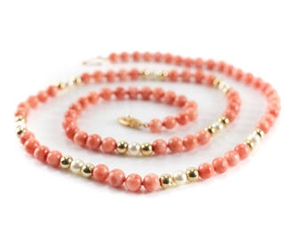 "14k Yellow Gold 7mm Coral and Cultured Pearl Single Strand Necklace. 28"" / 41g"