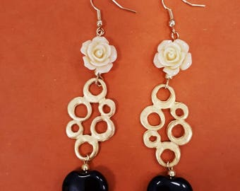 Circles of flowers and hearts, dangling earrings with onyx.