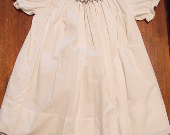 White anchor smocked dress for sizes 2, 3, and 4