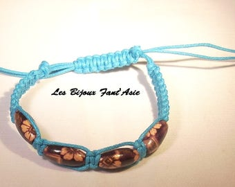 Dark purple wooden flower beads and turquoise macrame bracelet