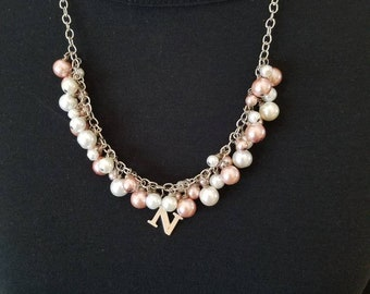 Pink and white pearl necklace with initial charm