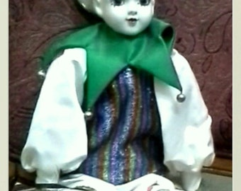 Vintage collectible Harlequin Court Jester Porcelin Doll with built in Jewelry Box