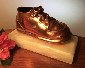 Vintage bronzed baby shoe on marble base