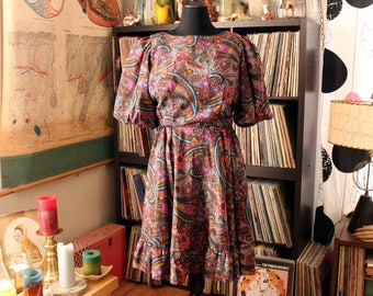vintage 1980s square dance dress by Jorrino, wild paisley print with circle skirt and puffed sleeves