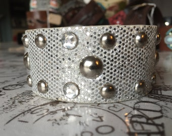 Silver and white cuff bracelet.