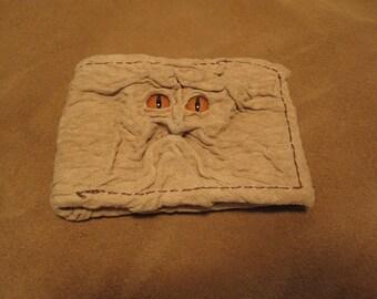 Grichels leather bi-fold wallet - crinkle textured cream with poppy orange slit pupil reptile eyes