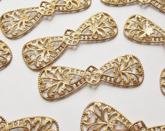 Vintage brass bow stampings