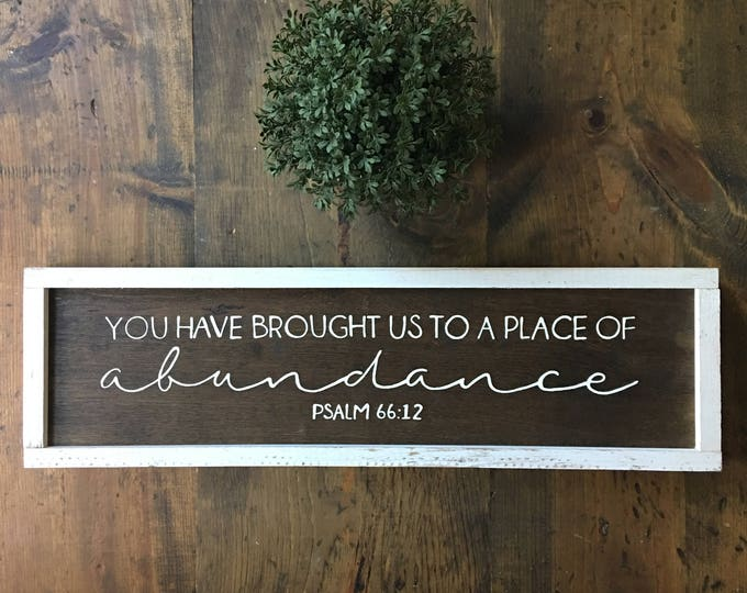 Hand Painted Framed Wooden Sign with Scripture Psalm 66:12 You Have Brought Us to a Place of Abundance