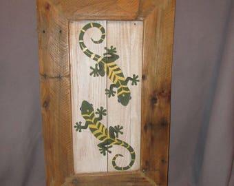 Hand painted geckos wall art on reclaimed wood.