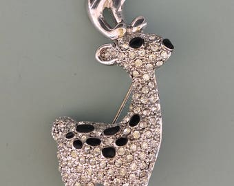 Lovely vintage reindeer with antlers brooch .