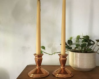 glam rose gold copper mid century candlestick holders. pair of two hollywood regency rose gold candlestick holders. interior design decor