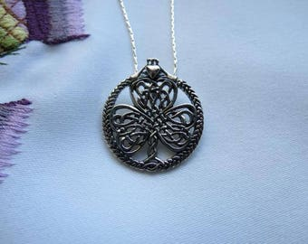 Sterling Silver Pendant interlacing Celtic Knots in the shape of a Shamrock with a Claddagh symbolizing friendship, loyalty, and love.