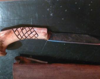 Etched bone knife