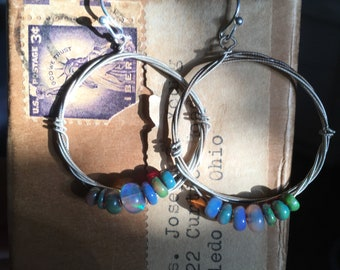 Strung-Out violin string hoop earrings with blue opal