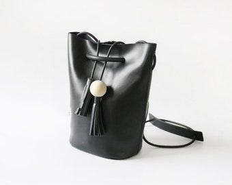 Small Black Leather Tote bag with Wood Tassel wholesale whole sale