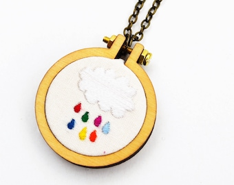 Rainbow raindrop cloud hoop necklace or brooch. Miniature 4cm Hand Embroidery Hoop Art