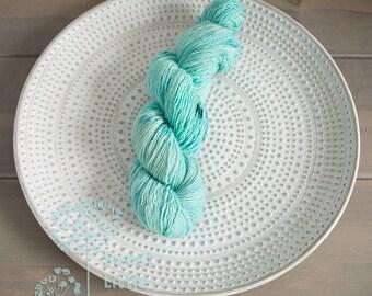 Beautiful hand dyed variegated blue hank of sports weight superwash merino wool single ply