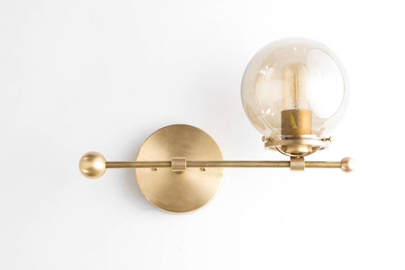 Modern wall sconce brass sconce lights mid century modern like this item aloadofball Image collections