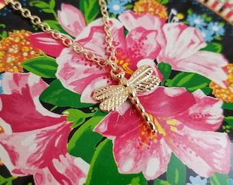 Golden dragonfly necklace. Adjustable choker length charm necklace