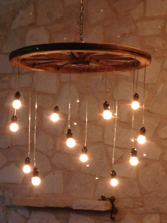 Random length wagon wheel chandelier large like this item mozeypictures Image collections
