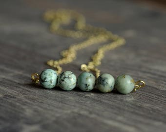 Delicate brass necklace with African turquoise matt