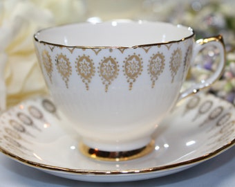 "ROYAL VALE Bone China Teacup and Saucer ""Pattern Number 7934"""