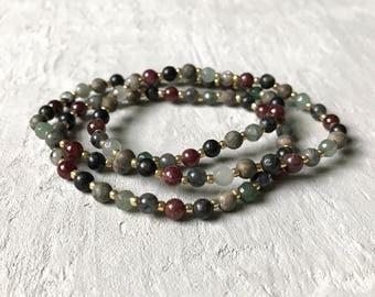 neutral toned gemstone bracelet with gold beads