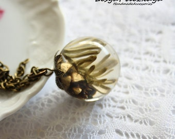 Globe pendant of crystal resin with a cone and fir tree - nature jewelry - woodland pendant