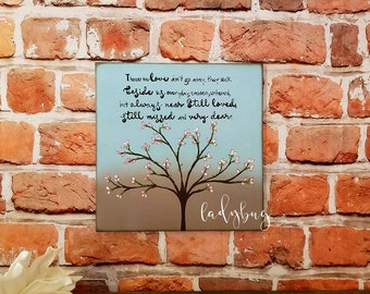 Those we love don't go away, they walk beside us everyday... In memory of. Board size 12x12. Handpainted by Ladybug