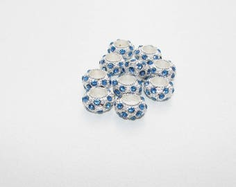 Bead sky blue rhinestones and metal Charms.