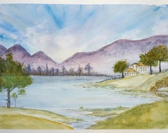 An original watercolor of a landscape with mountains, trees and river