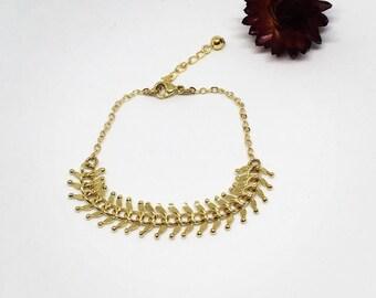 Gold plated spike bracelet