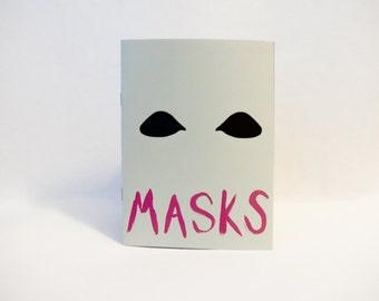 Masks - art zine full of illustrations of different masks.