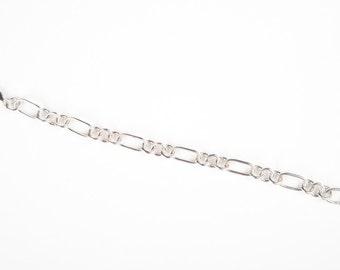 Sterling silver figaro charm style bracelet.